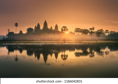 Sunrise view of popular tourist attraction ancient temple complex Angkor Wat with reflected in lake Siem Reap, Cambodia. Clipping path of sky