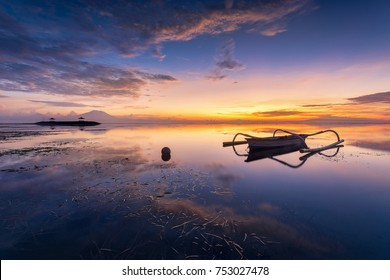 Sunrise view at Sanur Beach, Bali island, Indonesia. Soft focus due to long exposure.