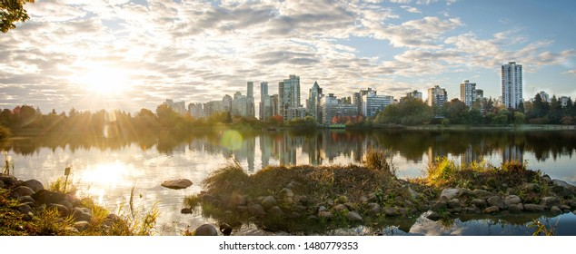 sunrise view of the skyscrapers around Lost Lagoon, Vancouver BC, around Stanley Park. Enjoy, keep calm, relax.