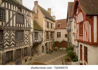 Sunrise view of a square (place de la petite etape aux vins), with half-timbered houses, in the medieval village Noyers-sur-Serein, Burgundy, France