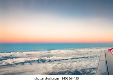 Sunrise view from the window of an airplane flying in the clouds, top view clouds like the sea of clouds sky background, Aerial view background, Yamanashi, Japan