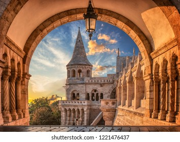 Sunrise viewed through the arches of the Fisherman's Bastion in Budapest, Hungary.