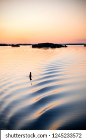 Sunrise Water with Ripple and Buoy