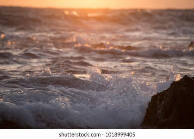 Sunrise and wave splash
