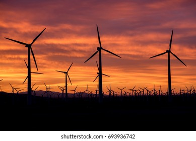 Sunrise at a windmill farm in California