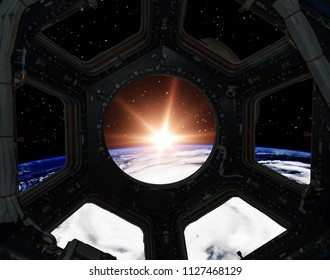 Sunrise from the window of a spaceship. Elements of this image furnished by NASA.