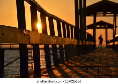 Sunrise and Wooden Jetty at Kenjeran Beach, Surabaya