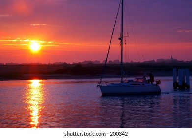 A sunrise in a yacht harbor in the city of Nieuwpoort, new port in belgium.