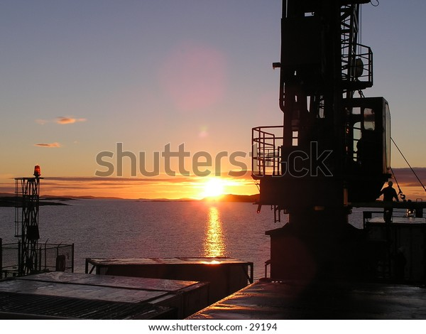 """Sunrise2 from the boat near  Tête-à-la-Baleine,""""Whale Head"""" in St. Lawrence River, North Shore,Quebec, Canada."""