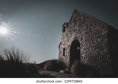 Sunrises across front of iconic  Church of Good Shepherd at Lake Tekapo New Zealand