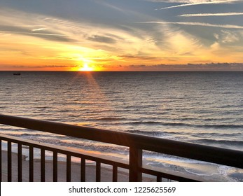 The sunrises over the Atlantic Ocean viewed from a oceanfront balcony.