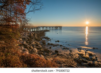 Sunrising in early morning with pier and nice small beach. Shot from Downs Park, Pasadena, MD USA