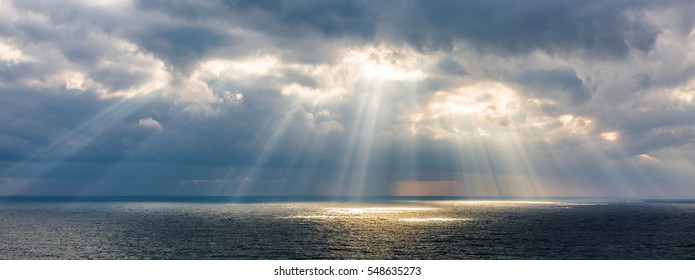 The sun's rays over the sea.