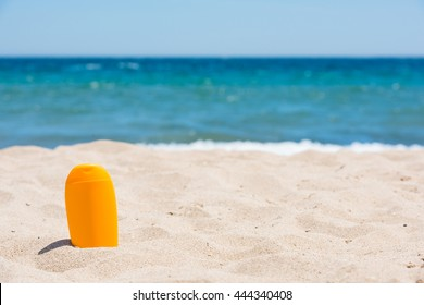 Sunscreen bottle on the beach