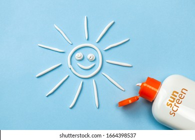 Sunscreen. Cream in the form of sun on blue background with white tube.