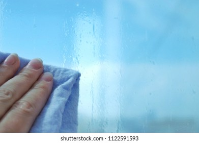 Sunscreen. Installation of sun film on window. Cleaning and washing windows with microfiber