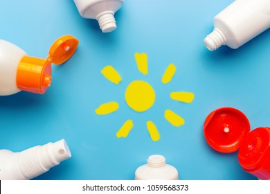 Sunscreen on blue background. relax on the beach concept