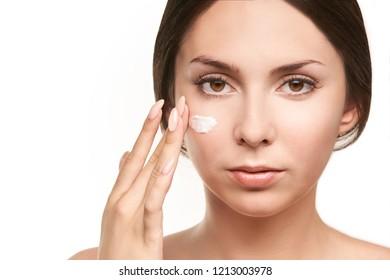 Sunscreen skin cream woman. care tan girl. Cancer damage.