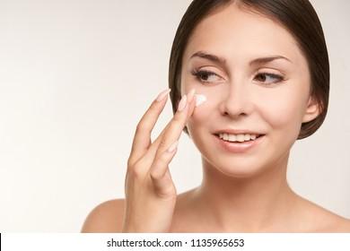 Sunscreen skin cream woman. Skincare tan girl.