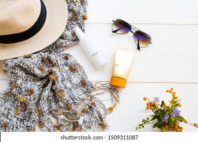 sunscreen spf50 ,collagen water cosmetics beauty makeup for skin face and sunglasses ,knitting wool scarf ,hat  of colorful lifestyle woman relax in winter season on background white