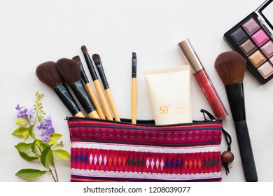 sunscreen spf50,eyes shadow,brush,lipstick and colorful bag set cosmetics beauty makeup of lifestyle woman on background white