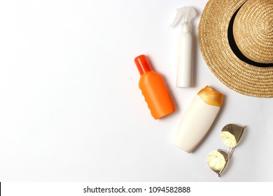 sunscreen, towel, hat, glasses on a white background. Cosmetics for safe sunburn. top view, flatlay