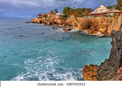 Sunset at 3 Dives point in Negril, Jamaica. The rocky outcrops are very popular for cliff jumping.