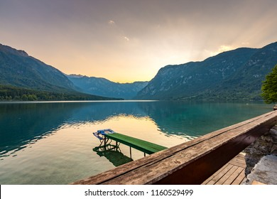 Sunset above Bohinj lake, Slovenia national park. Dramatic and magical colors, mystic water, mountains and Alps in background
