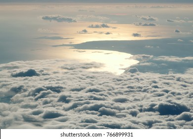 Sunset above clouds from airplane window