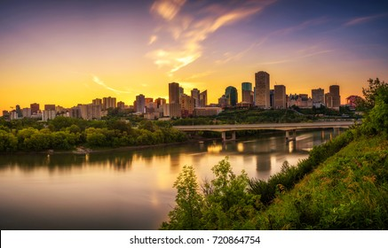 Sunset above Edmonton downtown, James Macdonald Bridge and the Saskatchewan River, Alberta, Canada. Long exposure.
