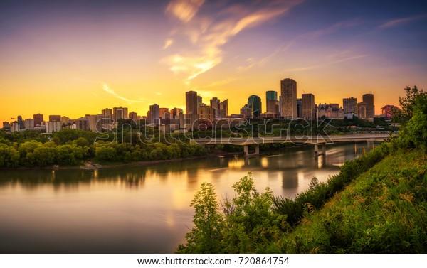 Sunset above Edmonton downtown, James Macdonald Bridge and the Saskatchewan River, Alberta, Canada. Long exposure.