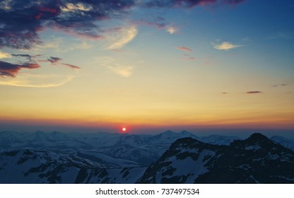 Sunset above the mountains, sunset in the snowy mountains
