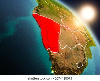 Sunset above Namibia from space on planet Earth with visible country borders. 3D illustration. Elements of this image furnished by NASA.