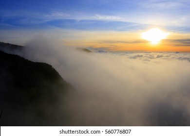Sunset above the sea of clouds in La Reunion island, French oversea department and region (Indian Ocean), France