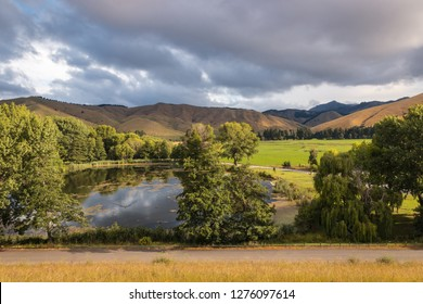 sunset above Taylor dam near Blenheim town in South Island, New Zealand