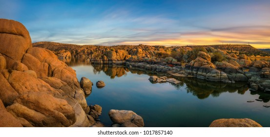 Sunset above Watson Lake in the Granite Dells of Prescott, Arizona. Long exposure.