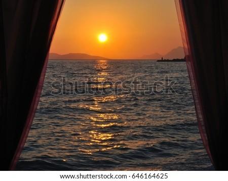 Sunset at adriatic sea in Podgora, Croatia