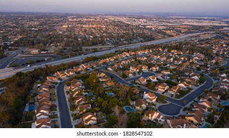 Sunset aerial view of a neighborhood in Chino Hills, California, USA.