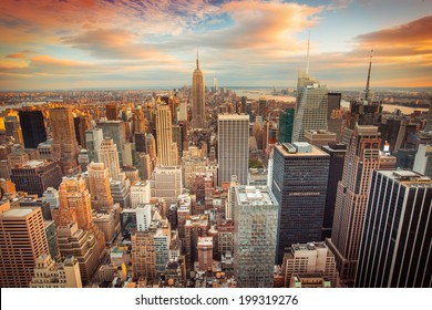 Sunset aerial view of New York City looking over midtown Manhattan towards downtown.