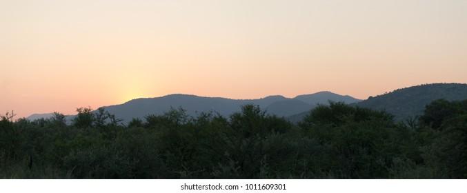 Sunset of African bush and sky tranquil beauty landscape Pilanesberg National Park, Kalahari, South Africa