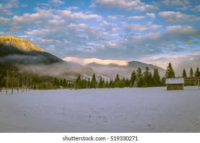 sunset after the first snowfall in the italian alps