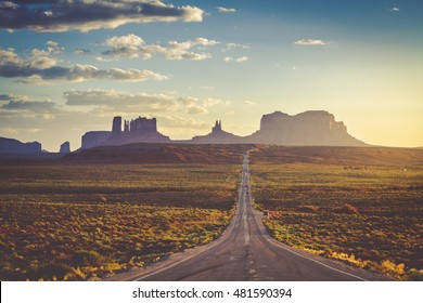 Sunset along stretch of highway at Utah Arizona border known as Forest Gump Point and entrance to Monument Valley Navajo Tribal Park