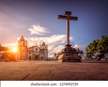 Sunset at Alto da Se hill in Olinda, Pernambuco, Brazil with the baroque architecture of Igreja da Se church and the Cruzeiro.