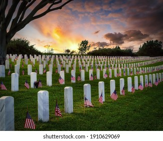 Sunset and American flags on Memorial Day at a national cemetery in southern California.