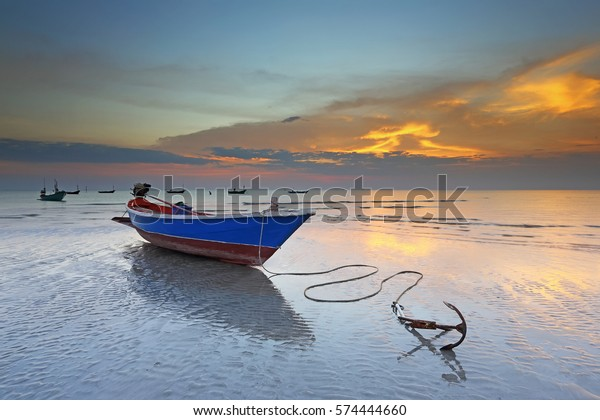 Sea Coast, The Adriatic Sea. A Wooden Fishing Boat Stands