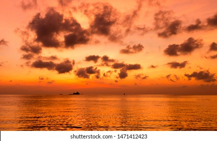Sunset in the Andaman Sea of the Indian Ocean on sailing yacht on the Similan Islands. Bright colors of the sky and clouds over the rocky islands, Thailand. Holiday vacation in a cruise from Phuket.