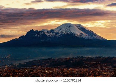 Sunset in the Andes mountain range, the last rays of sun touch the Chimborazo and the Carihuairazo