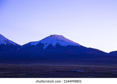 Sunset in Andes. Parinacota volcano. High Andean landscape in the Andes. High Andean tundra landscape in the mountains of the Andes.