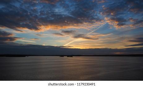 sunset at archipelago sea in sweden