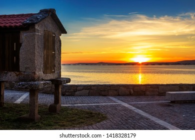 Sunset in Arousa Estuary with horreo traditional barn